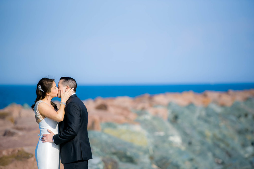 Bride and groom share a kiss at the 31st Street Beach before their Bridgeport Art Center wedding in Chicago.