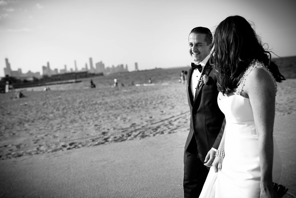 The couple takes a stroll down the 31st Street Beach on their way to their Bridgeport Art Center wedding in Chicago.