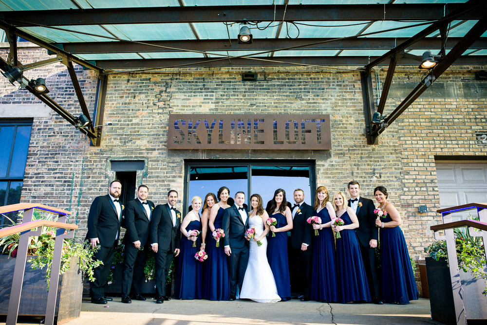 Wedding party outside the Bridgeport Art Center Skyline Loft entrance in Chicago.