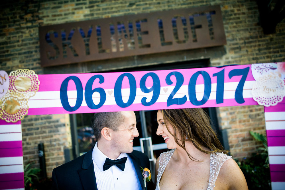 Bride and groom outside the Bridgeport Art Center Skyline Loft entrance in Chicago.