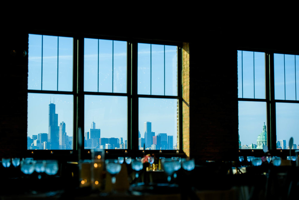 View of downtown Chicago from the Bridgeport Art Center Skyline Loft during a wedding reception.