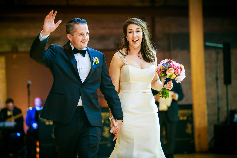 Bride and groom are introduced during their Bridgeport Art Center wedding in Chicago.