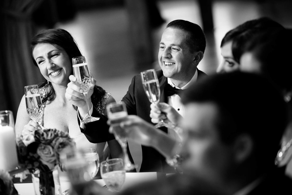 The couple toasts during their Bridgeport Art Center wedding in Chicago.