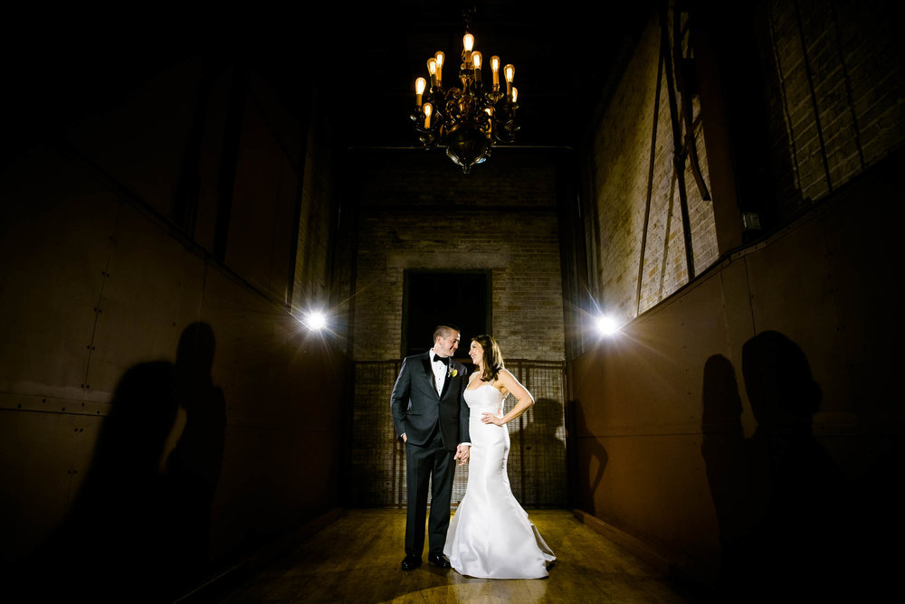 Night portrait in the freight elevator during a Bridgeport Art Center wedding in Chicago.