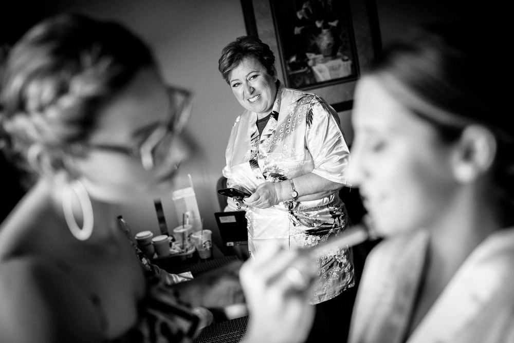 Mother of the bride admires her daughter while getting ready before a wedding at Independence Grove in Libertyville.