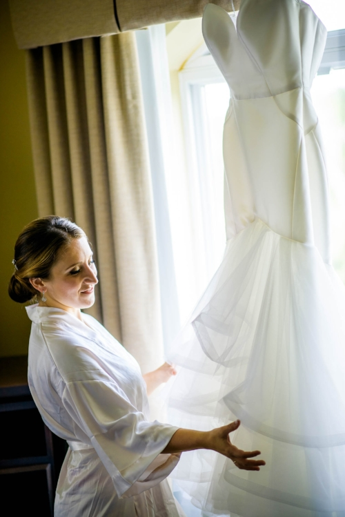 Bride admires her wedding dress before her big day at Independence Grove in Libertyville.