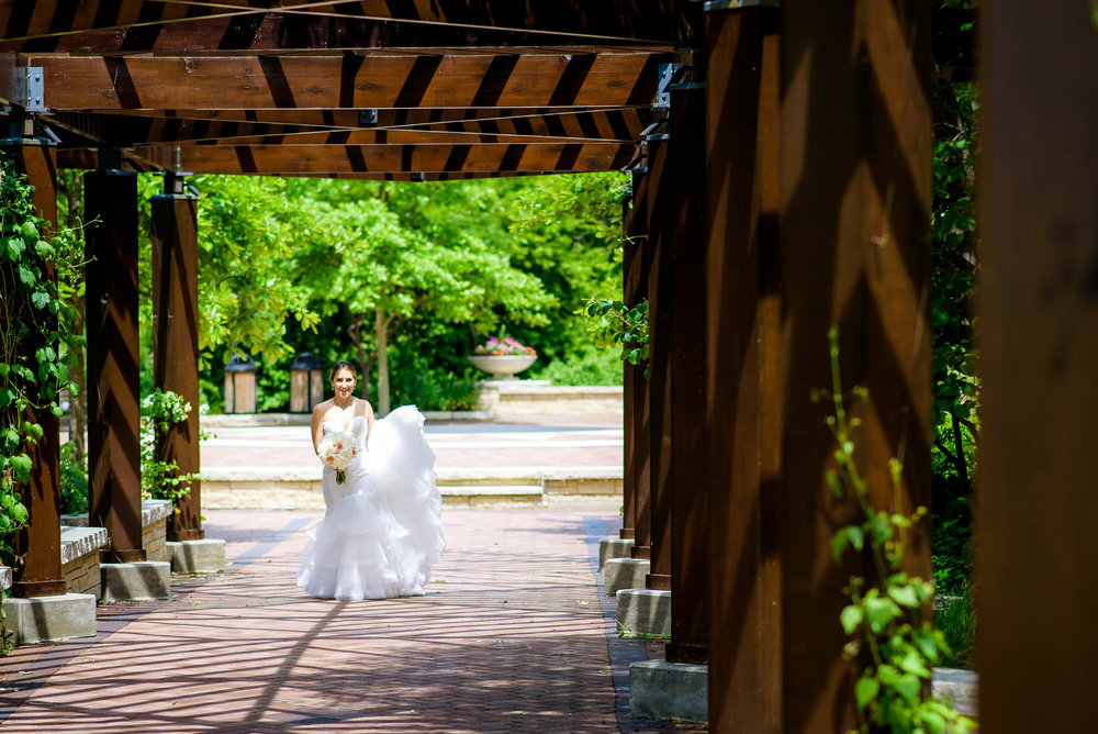 Bride approaches during a first look at Independence Grove in Libertyville.