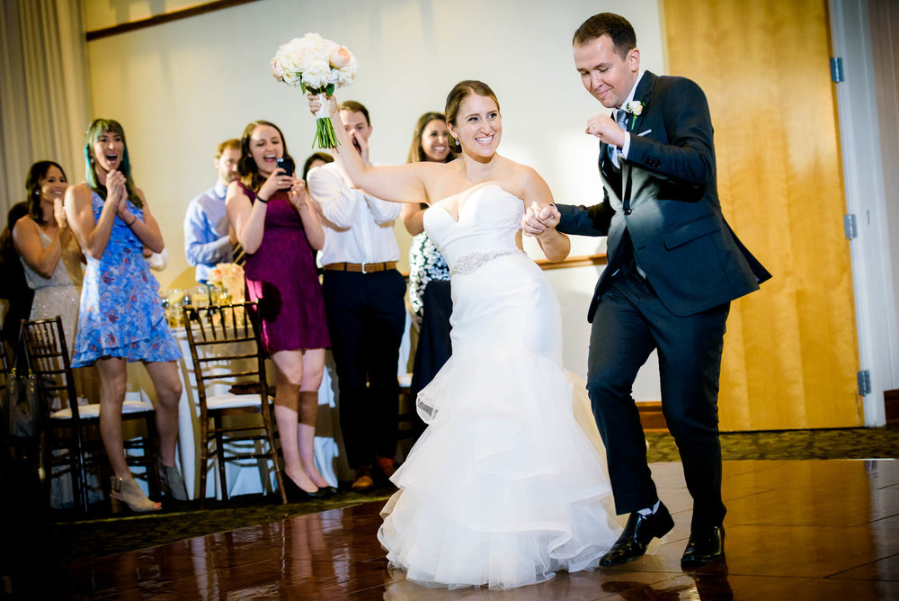 Bride and groom dance when introduced at their wedding at Independence Grove in Libertyville.