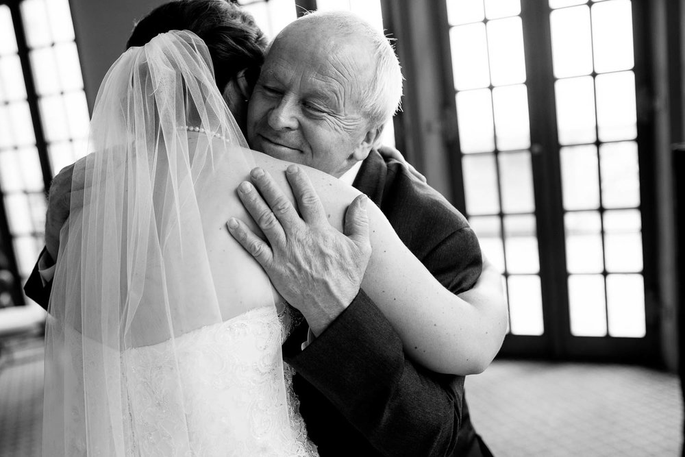 Father-daughter hug during a University Club of Chicago wedding.