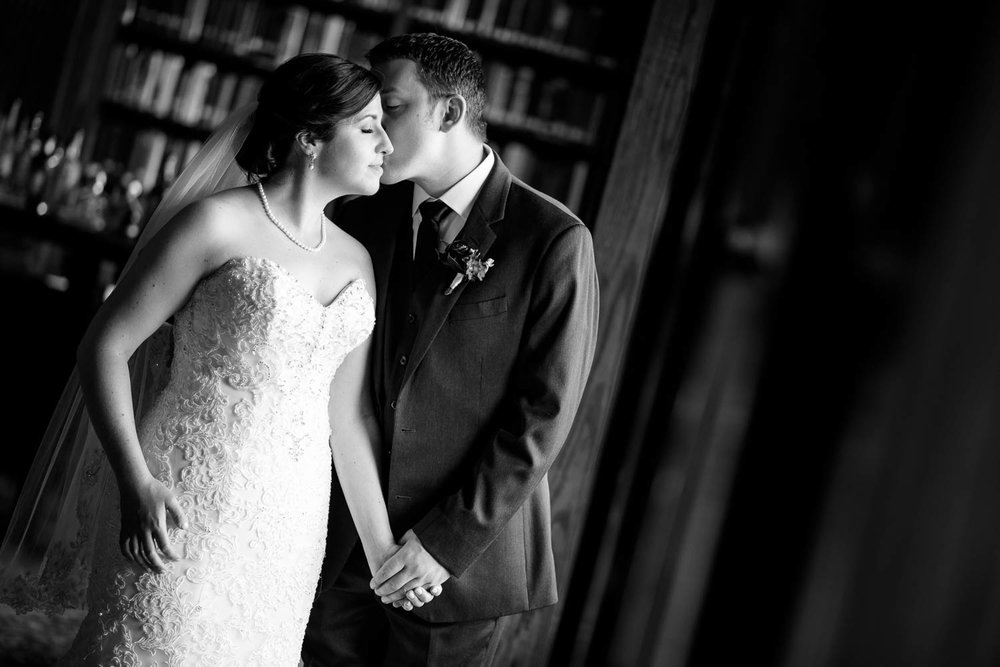 Bride and groom embrace during their University Club of Chicago wedding.