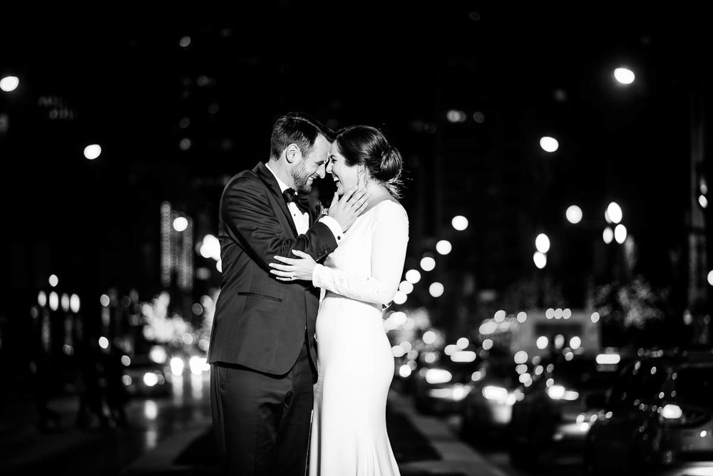 Bride & groom embrace on Michigan Avenue during the MCA Chicago winter wedding.