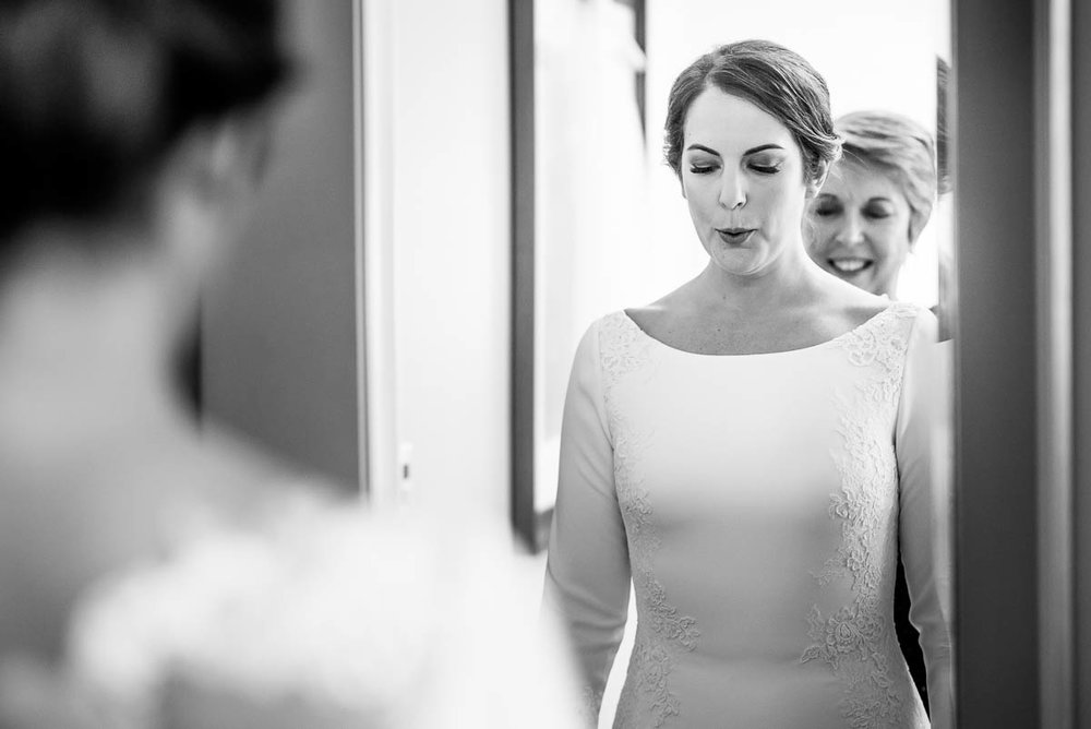 Emotional moment while bride getting ready at the Waldorf Astoria during her MCA Chicago winter wedding.