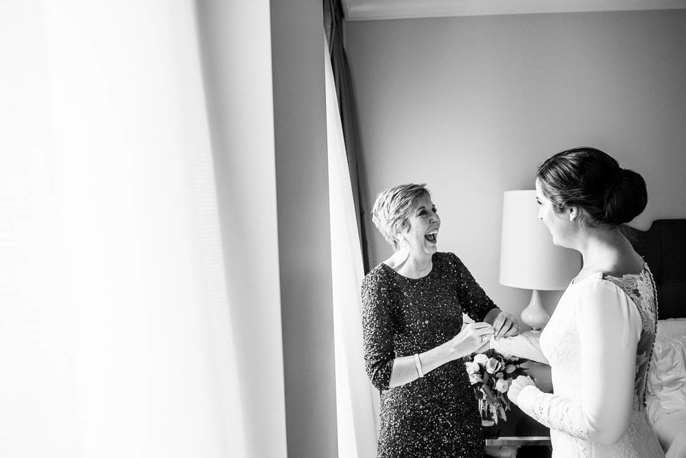 Mother and bride share a moment while getting ready at the Waldorf Astoria during her MCA Chicago winter wedding.