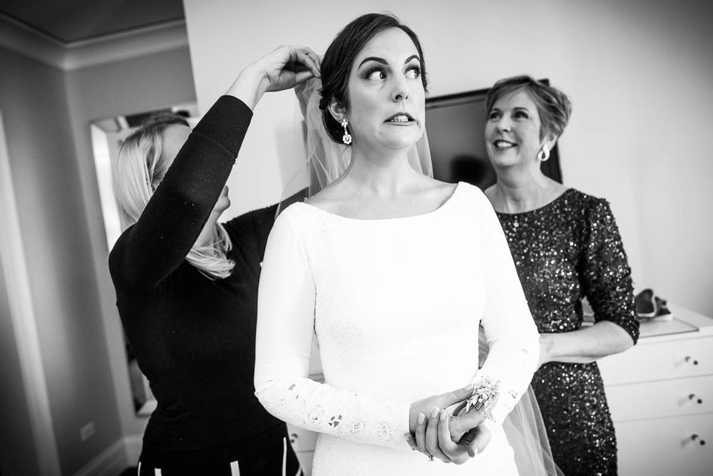 Funny moment of bride getting ready at Waldorf Astoria during her MCA Chicago winter wedding.