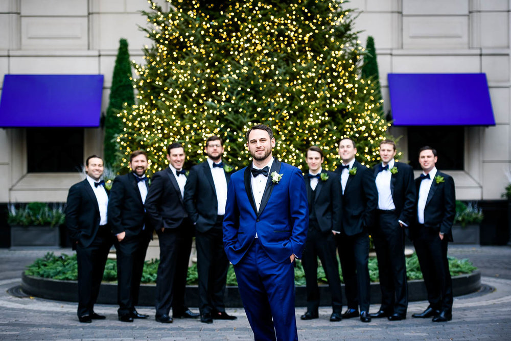 Groomsmen portrait outside the Waldorf Astoria during a MCA Chicago winter wedding.