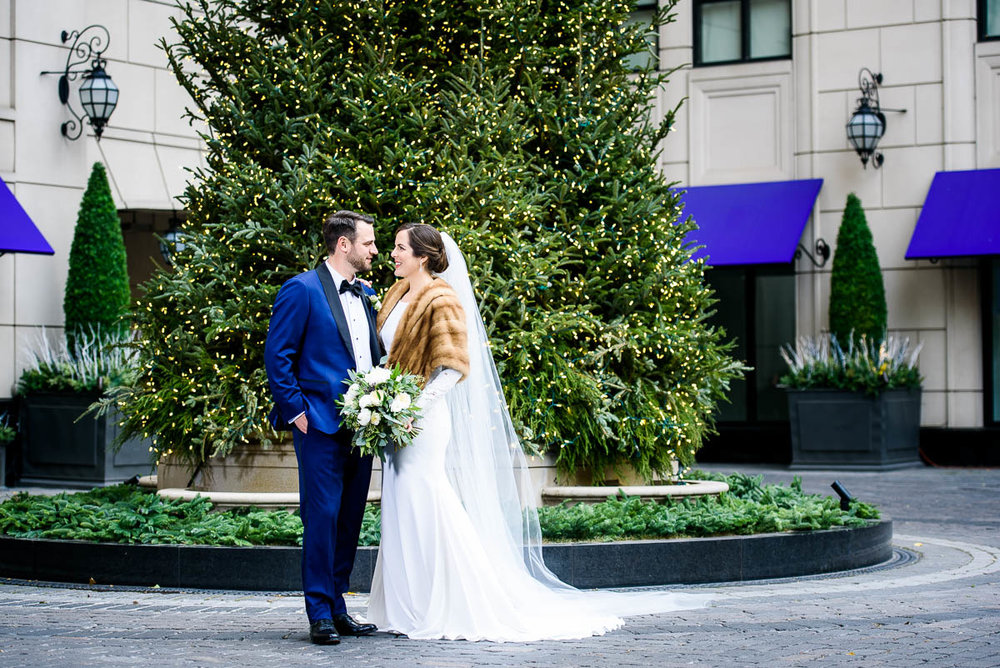 Bride & groom outside the Waldorf Astoria during their MCA Chicago winter wedding.