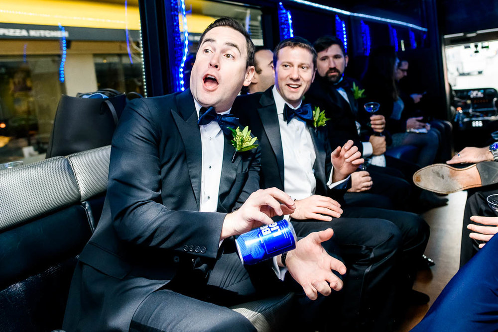 Groomsmen throwing beers to each other on the way to the ceremony at St. James Chapel Chicago.