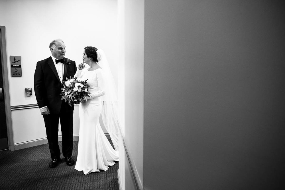 Father and the bride share a moment before the ceremony at St. James Chapel Chicago.