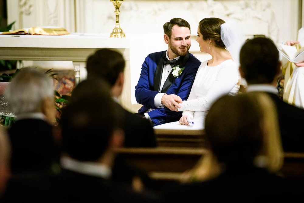 Bride & groom share a moment during their wedding ceremony at St. James Chapel.