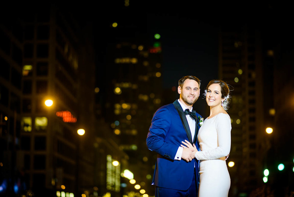 Wedding portrait of the bride & groom on Michigan Avenue during their MCA Chicago winter wedding.