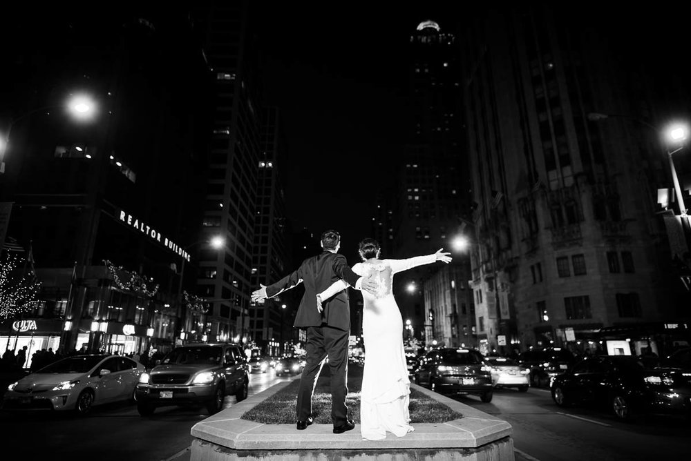 Fun creative wedding portrait of the couple on Michigan Avenue during their MCA Chicago winter wedding.