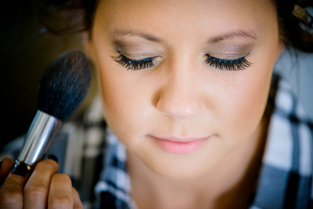 Bride getting ready during her wedding at the Manor House in Littleton, Colorado.
