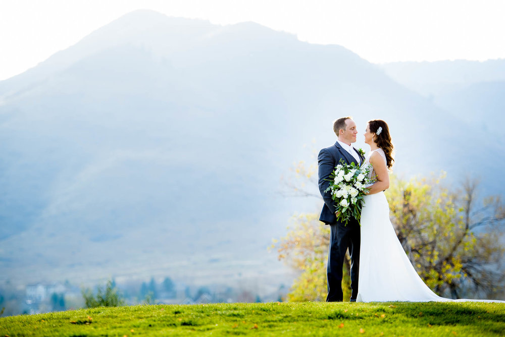 Bride & groom against the mountains during their wedding at the Manor House in Littleton, Colorado.