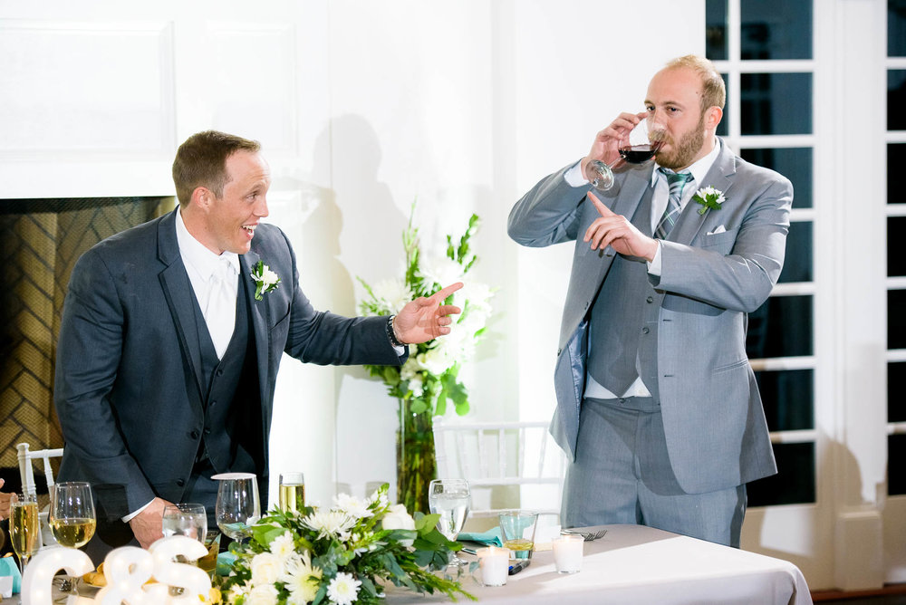 Funny moment between groom and best-man during a wedding at the Manor House in Littleton, Colorado.