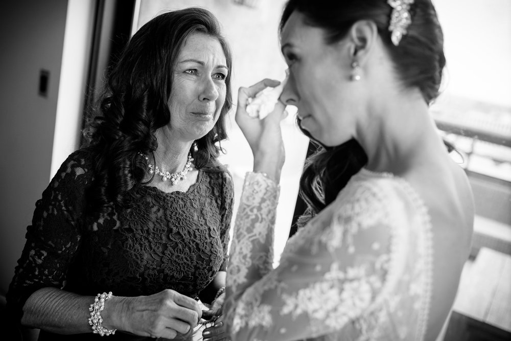 Emotional moment between bride and mother before a Thompson Chicago wedding.