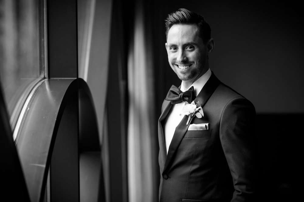 Portrait of the groom before his Thompson Chicago wedding.