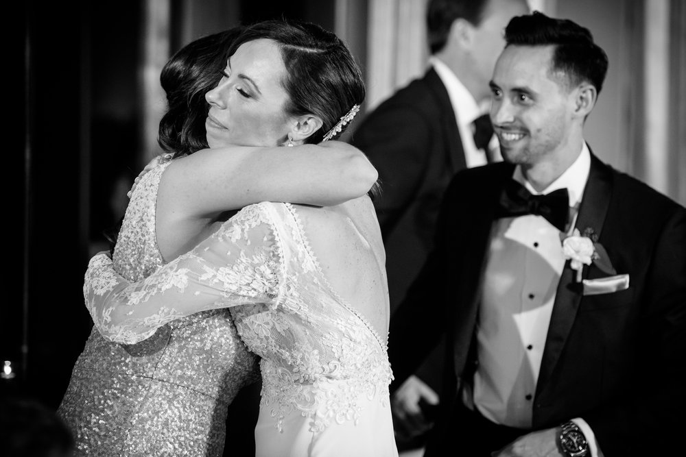 Bride and maid of honor hug after her toast at the Thompson Chicago.