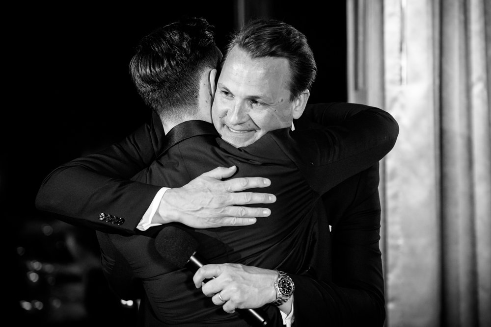 Groom and best man hug after his toast at the Thompson Chicago.