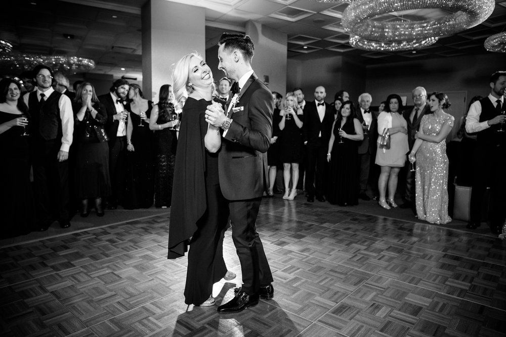 Groom and sister dance during a Thompson Chicago wedding reception.