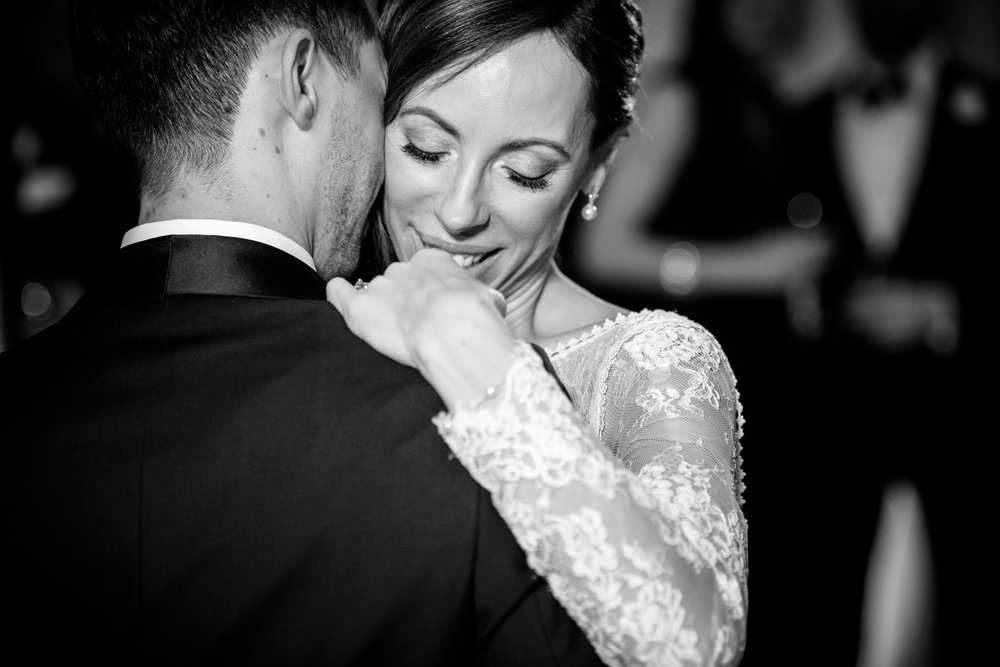 Emotional bride and groom first dance during their Thompson Chicago wedding reception.