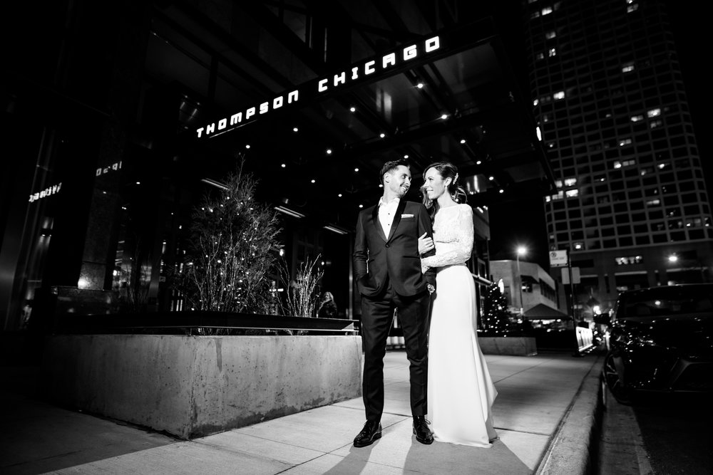 Creative wedding night portrait outside the Thompson Chicago.