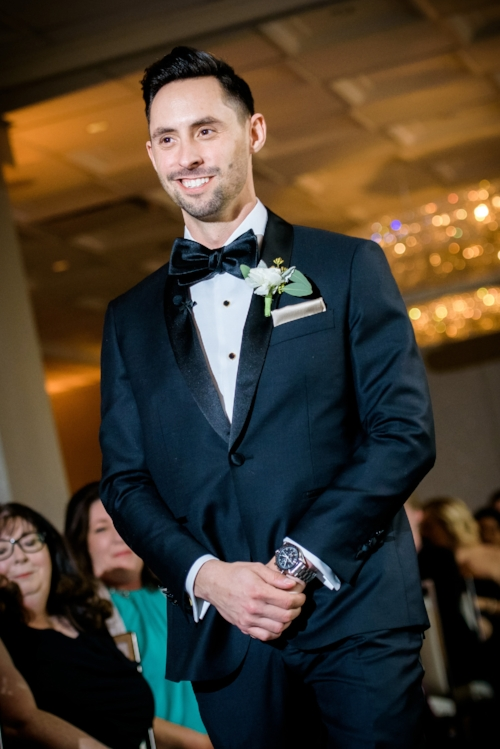 Groom walks down the aisle during his Thompson Chicago wedding.
