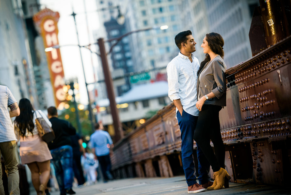 Chicago engagement session on the Chicago River outside the Chicago Theater.
