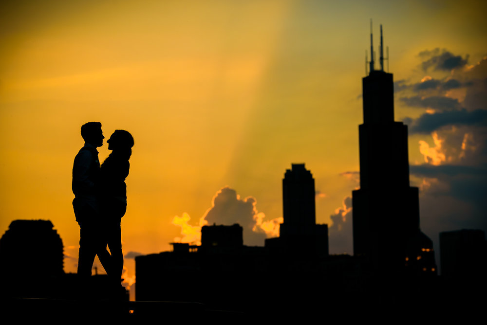 Chicago engagement session on Lake Michigan at sunset outside the Shedd Aquarium.