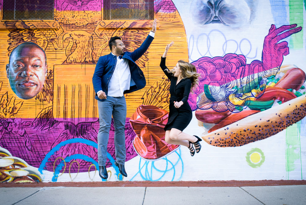 Fun engagement photo in front of street art in Humboldt Park Chicago.