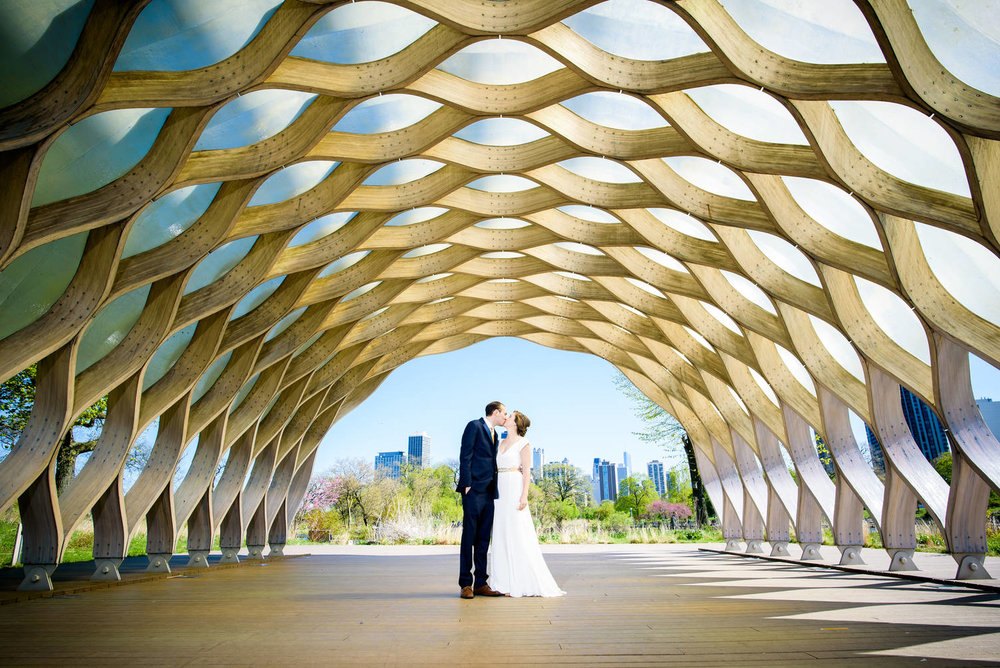 Wedding photo of bride and groom at the honeycomb sculpture in Lincoln Park Chicago.