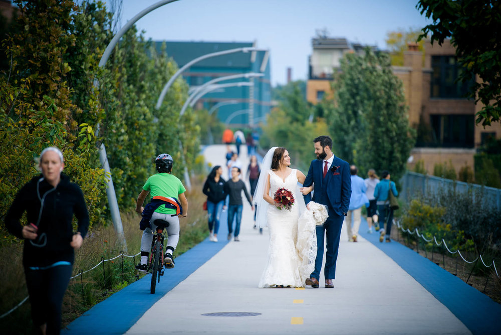 Bride and groom walk down the 606 trail during their Logan Square wedding in Chicago.