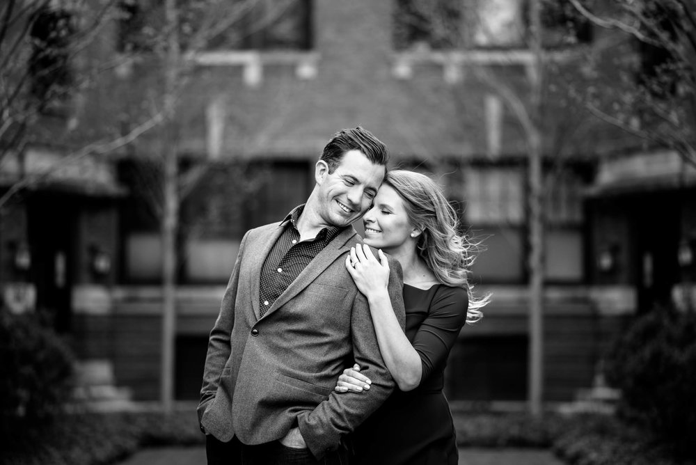 Couple outside their Lincoln Park home during their Chicago engagement session.