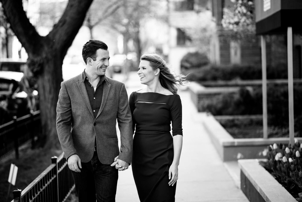 Bride and groom take a stroll outside their Lincoln Park home during their Chicago engagement session.