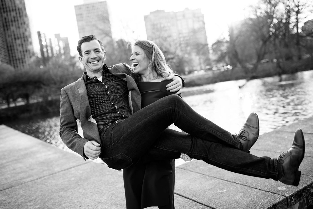 Hilarious fun engagement photo outside the nature museum in Lincoln Park Chicago.