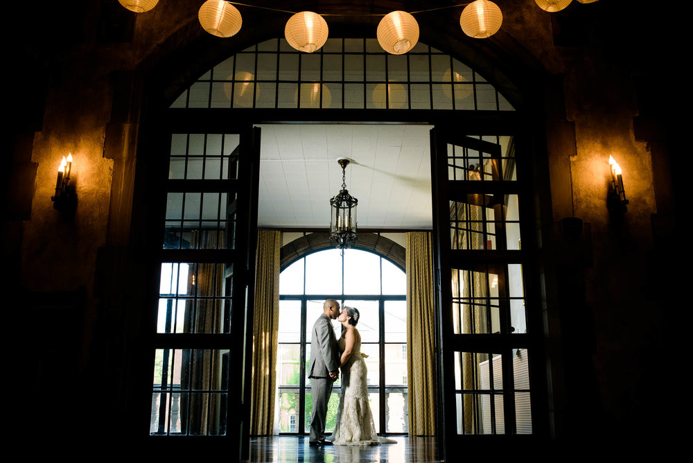 Bride and groom kiss before their Quadrangle Club of Chicago reception.