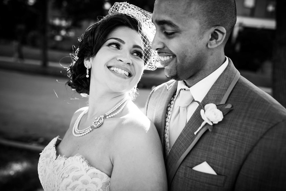Intimate portrait of bride and groom during their University of Chicago wedding.
