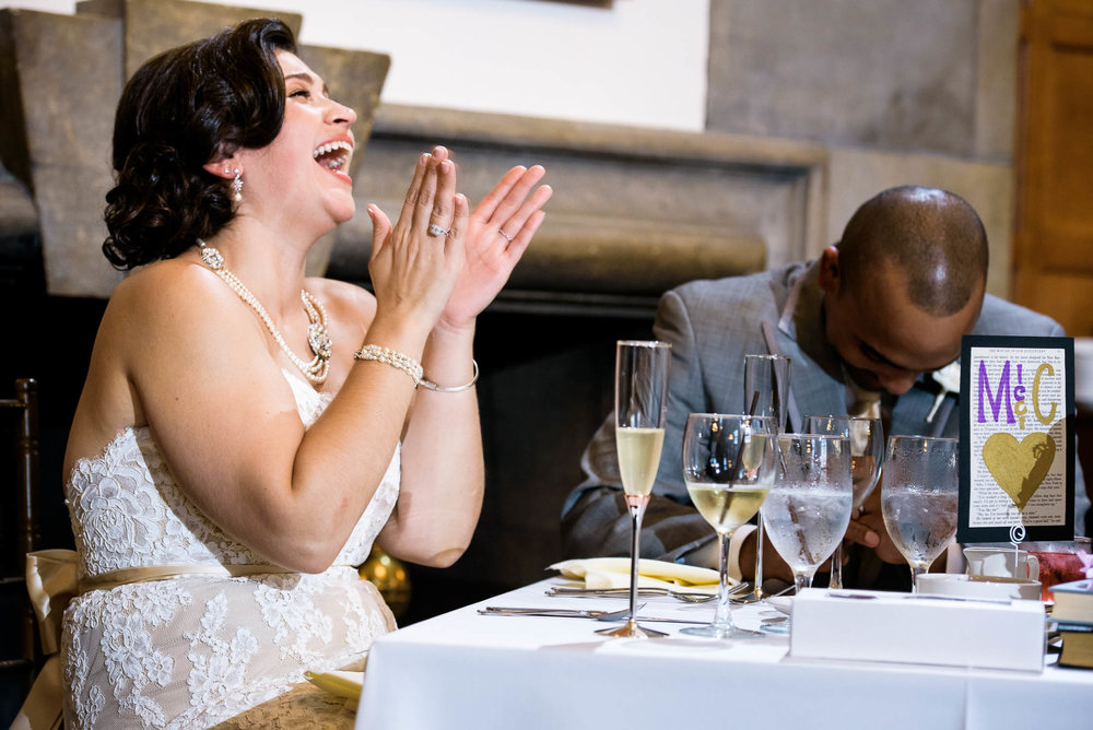 Bride and groom laughter during the toasts at their Quadrangle Club of Chicago wedding.