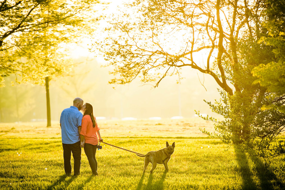 Sunset engagement session with the couple's dog at Montrose Harbor in Chicago.