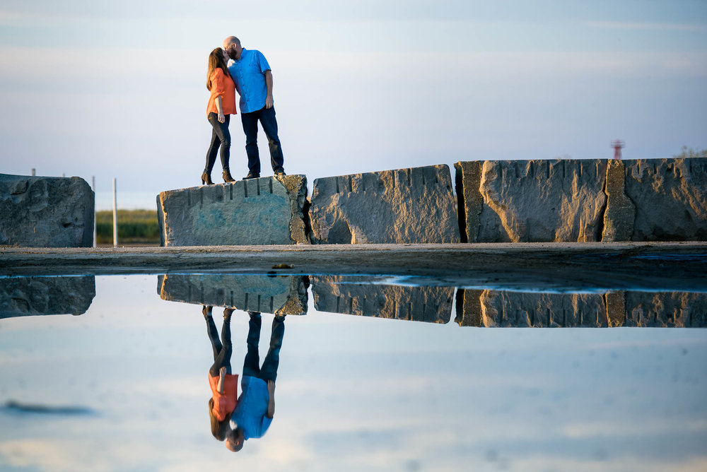 Couple shares a kiss during their engagement session at Montrose Beach in Chicago.