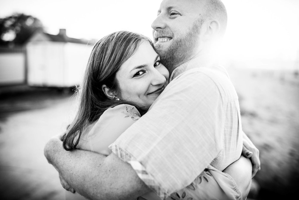 Couple hugs during their Montrose Beach engagement session in Chicago.